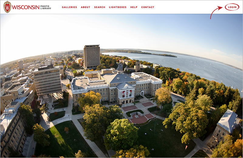 "Screen shot of the home page of the UW Photo Library with an arrow pointing to ""LOGIN"" in the upper right corner."
