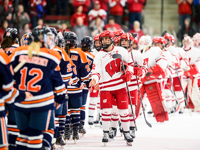 Badgers hockey players line up to congratulate the other team