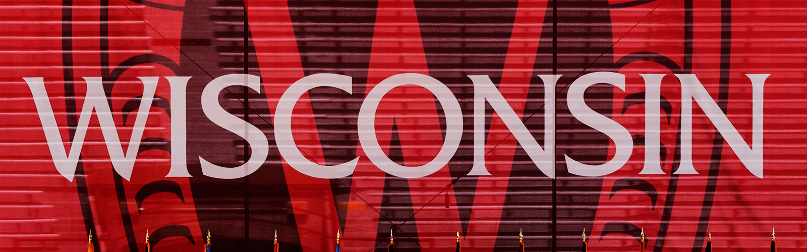 """A red banner used for commencement with the word """"Wisconsin"""""""