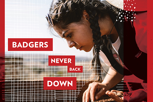 """A woman looks through sifted dirt, accompanied by the phrase """"Badgers never back down."""""""