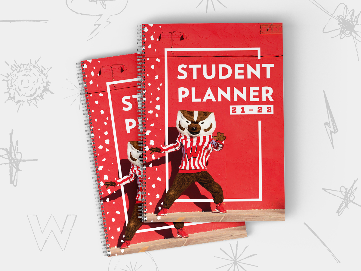 Photo of the cover of two student planners with Bucky